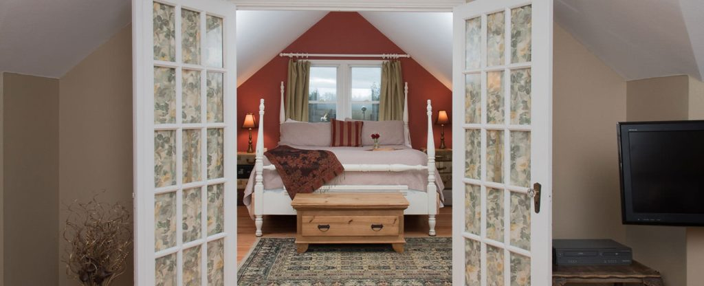 French doors open to a bedroom